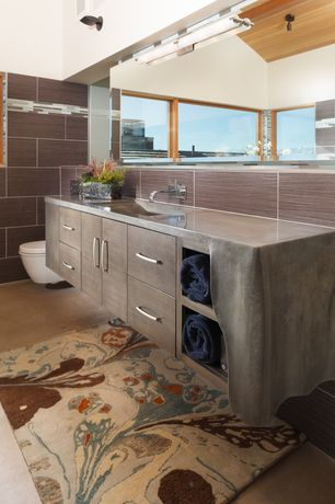 Contemporary Master Bathroom with Flush, Stainless steel counters, Paint 1, Stone Tile, picture window, European Cabinets