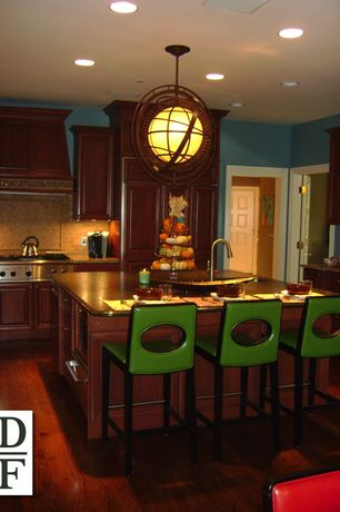 Eclectic Kitchen with L-shaped, warming oven, Raised panel, Kitchen island, Standard height, Framed Partial Panel, can lights
