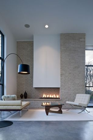 Contemporary Living Room with Knoll Barcelona Couch, Ivory, Knoll Barcelona Chair, Ivory, Concrete tile , High ceiling
