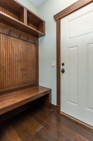Craftsman Mud Room with six panel door, Standard height, Built-in bookshelf, Hardwood floors