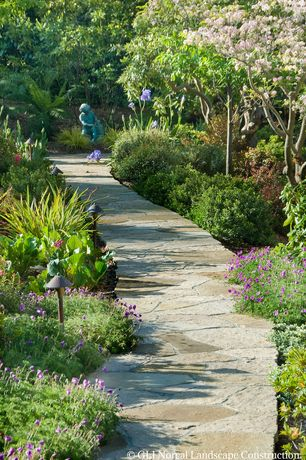 Traditional Landscape/Yard with exterior stone floors, Pathway