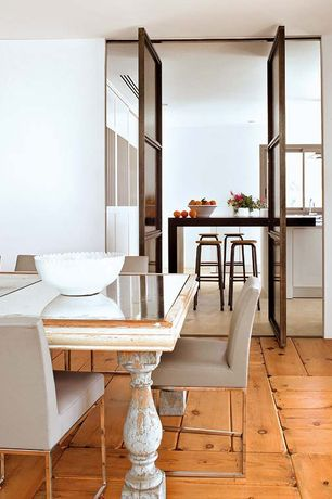 Contemporary Dining Room with Standard height, French doors, Hardwood floors