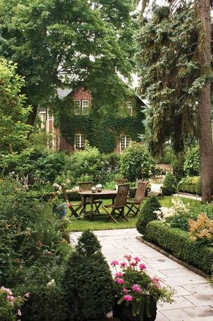 Traditional Landscape/Yard with Raised beds, Pathway, Fence