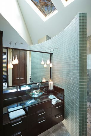 Modern Master Bathroom with European Cabinets, Pendant light, Flush, Vessel sink, specialty door, Glass counters, Skylight