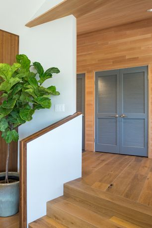 Contemporary Entryway with French doors, Standard height, can lights, Hardwood floors
