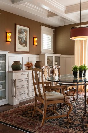 Traditional Dining Room with Wall sconce, Exposed beam, French doors, Built-in bookshelf, Wainscotting, flush light