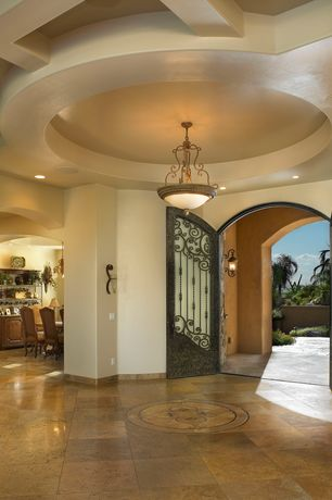 Mediterranean Entryway with Custom clark hall iron doors, Standard height, Wall sconce, Paint, Box ceiling, stone tile floors