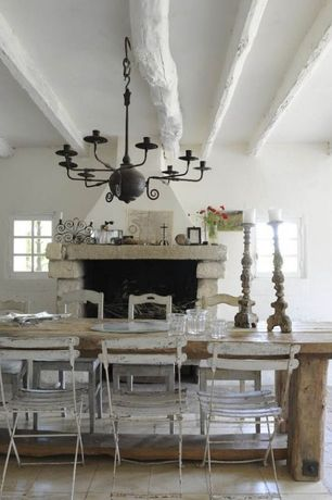 Rustic Dining Room with Chandelier, Exposed beam, stone fireplace, Standard height, Concrete tile , Fireplace, Casement