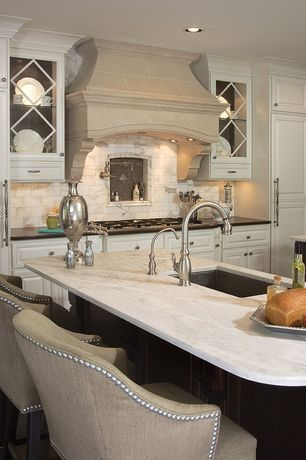 Traditional Kitchen with Crown molding, Subway Tile, Custom hood, MS International - Carrara White Marble Countertop