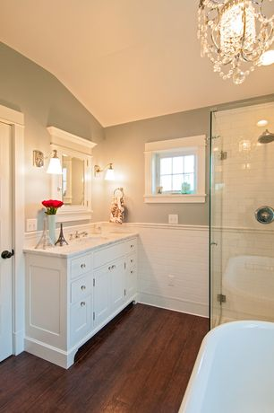 Traditional Master Bathroom with Rain shower, Freestanding, Chandelier, Hardwood floors, Undermount sink, Inset cabinets