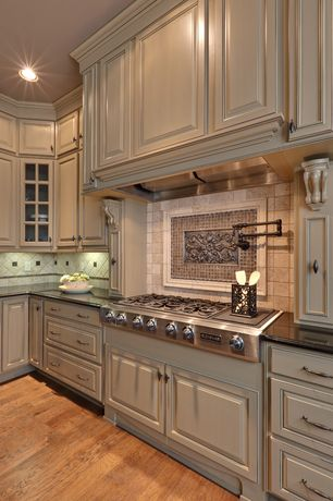 """Country Kitchen with Hardwood floors, Crown molding, Jenn-Air Pro-Style Gas Rangetop 36"""", Built-in bookshelf"""