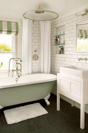 Traditional Full Bathroom with 'the chesterton' from penhaglion cast iron bathtub, Vessel sink, limestone tile floors
