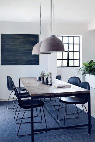 Modern Dining Room with Hardwood floors, Pendant light, Exposed beam