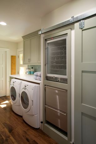 Modern Laundry Room with can lights, laundry sink, Drop-in sink, Paint 1, Armstrong hardwood flooring in oak, Paint 2