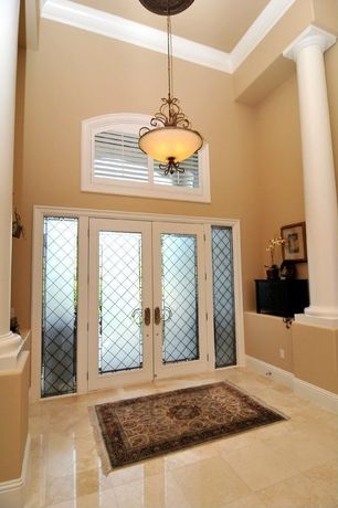 Traditional Entryway with Columns, Glass panel door, travertine floors, Pendant light, High ceiling, Crown molding