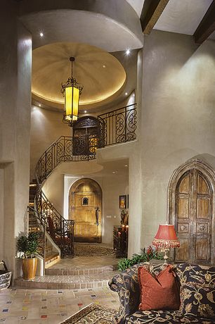 Mediterranean Entryway with Loft, High ceiling, Barn door, Pendant light, limestone floors, can lights