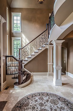 Traditional Staircase with High ceiling, Kesir travertine tile - antique pattern sets, Hardwood floors, Wrought iron railing