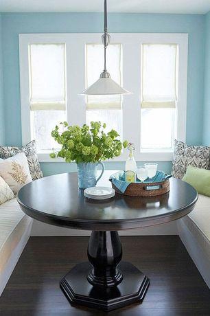 Traditional Dining Room with Breakfast nook, The shade store custom flat roman shade, Hardwood floors, Pendant light