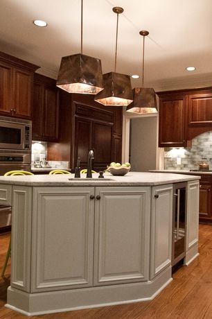 Traditional Kitchen with Kitchen island, double wall oven, can lights, L-shaped, Raised panel, Undermount sink, Pendant light