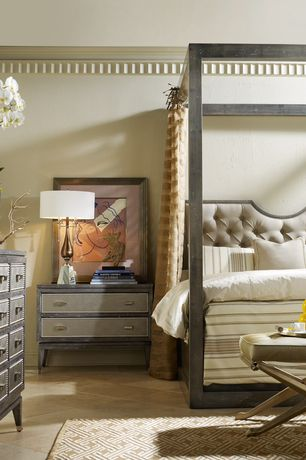 Contemporary Master Bedroom with Antique Mirror-legged Vanity Stool, Crown molding, Metal bedframe, travertine tile floors