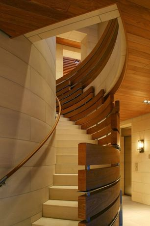 Contemporary Staircase with High ceiling, curved staircase, Hardwood floors