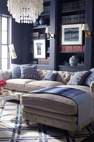 Contemporary Living Room with Oly Lighting Serena Chandelier, Area rug, Hardwood floors, Chandelier, Built-in bookshelf