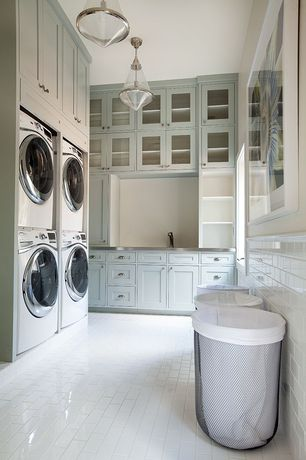 Traditional Laundry Room with Luxetile white subway tile, Built-in bookshelf, flush light, Top ranking enterprise