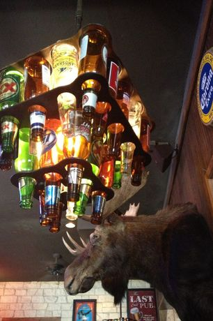 Rustic Bar with Moose head, Beer bottle chandelier, Interior brick wall, Wood panel wall, Ceiling fan
