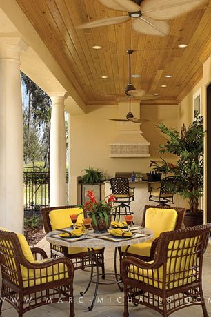 Tropical Patio with Stucco, Coral coast sahara 30 in. round mosaic bistro table, Vintage rust ceiling fan, Tuscan column