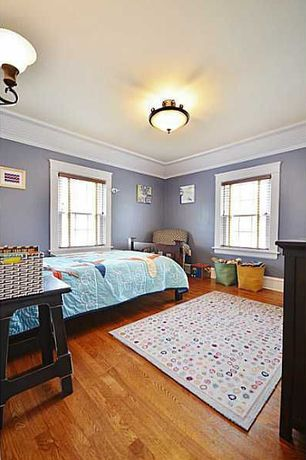 Traditional Kids Bedroom with Hardwood floors, double-hung window, Standard height, Crown molding, Wall sconce, flush light
