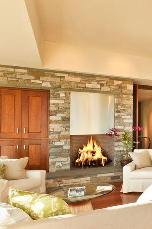 Craftsman Living Room with Laminate floors, Standard height, Fireplace, brick fireplace, Dutch door