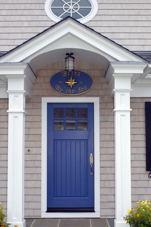 Cottage Front Door with exterior tile floors, Blue front door, Cedar shingle siding, Custom shutters, Glass panel door