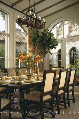 Traditional Dining Room with High ceiling, French doors, picture window, Arched window, limestone floors, Chandelier