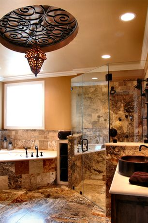 Eclectic Master Bathroom with Standard height, Jetted, stone tile floors, frameless showerdoor, Crown molding, Vessel sink