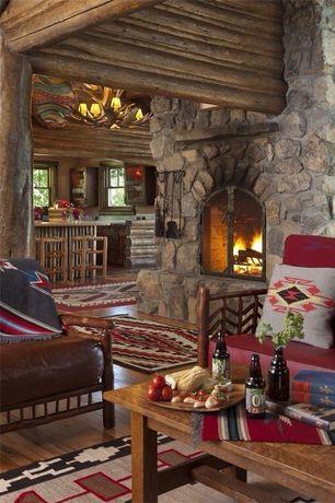 Rustic Living Room with stone fireplace, Columns, Chandelier, High ceiling, Mule deer antler single tier chandelier - 6 light