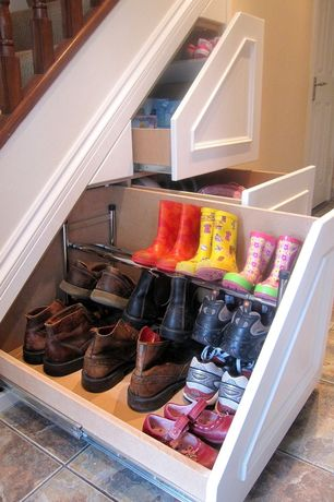 Traditional Mud Room with Under stair storage system, Built in storage, Paint, stone tile floors, Under stair storage