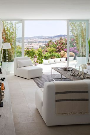 Contemporary Living Room with stone tile floors, French doors, travertine tile floors, Standard height