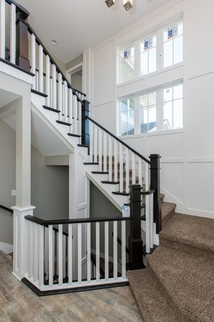 Traditional Staircase with Chandelier, Carpet, Cathedral ceiling, Crown molding