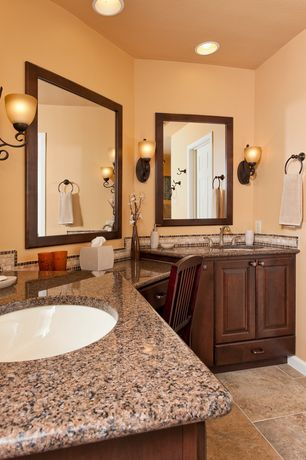 Traditional Master Bathroom with Simple granite counters, Raised panel, Ceramic Tile, Wall sconce, Flush, Master bathroom