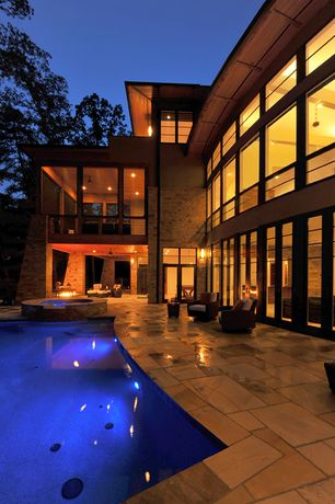 Contemporary Swimming Pool with exterior stone floors, Pool with hot tub, Transom window, French doors