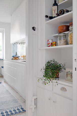 Cottage Pantry with Swedish design, Built-in bookshelf, Stainless steel bin drawer pulls, Cabinet, Hardwood floors