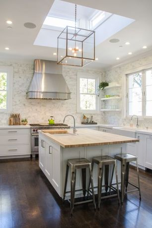 Traditional Kitchen with Wood counters, can lights, Farmhouse sink, Standard height, Wood Countertop in Hickory Plank