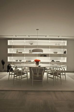 Contemporary Dining Room with Hardwood floors, Built-in bookshelf, Pendant light