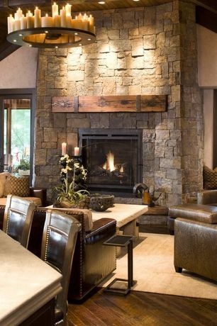 Rustic Living Room with Chandelier, Hardwood floors, French doors, High ceiling, stone fireplace