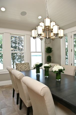 Traditional Dining Room with Chandelier, Paint 2, Salvaged wood dining table, Crown molding, travertine floors, can lights