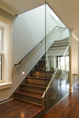 Contemporary Staircase with High ceiling, Hardwood floors, Crown molding