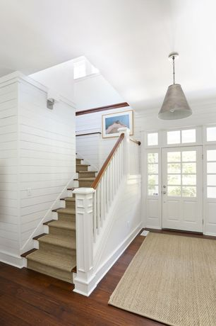 Cottage Entryway with Standard height, Pendant light, Transom window, Glass panel door, Hardwood floors