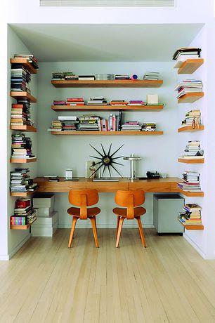 Contemporary Home Office with Nelson sunburst clock, Grande floating wall shelf, Built-in bookshelf, Laminate floors