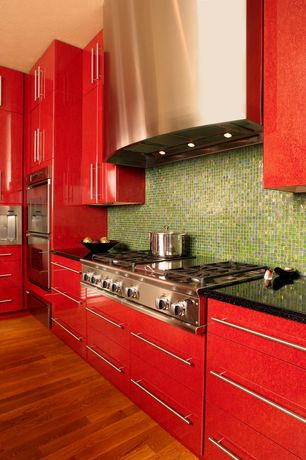 Modern Kitchen with Standard height, double wall oven, Lacquer cabinets, Ceramic Tile, can lights, full backsplash, Wall Hood
