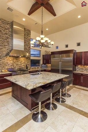 Contemporary Kitchen with Kitchen island, Breakfast bar, Flat panel cabinets, Complex granite counters, Pendant light, Flush